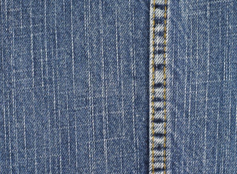 As calças de brim texture com emenda foto de stock