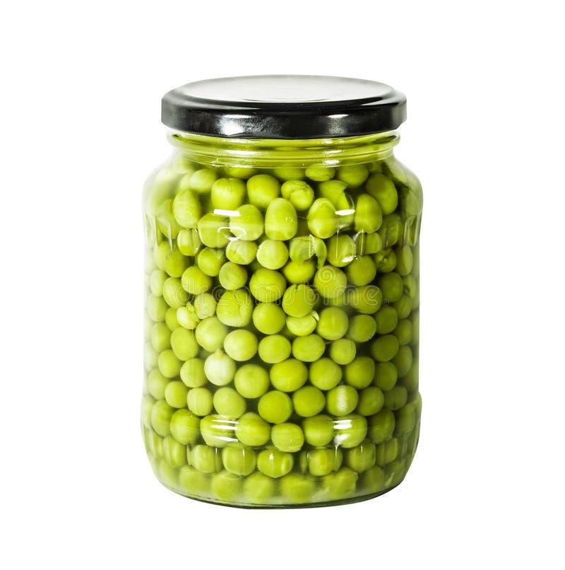 As ervilhas verdes em um vidro foto de stock