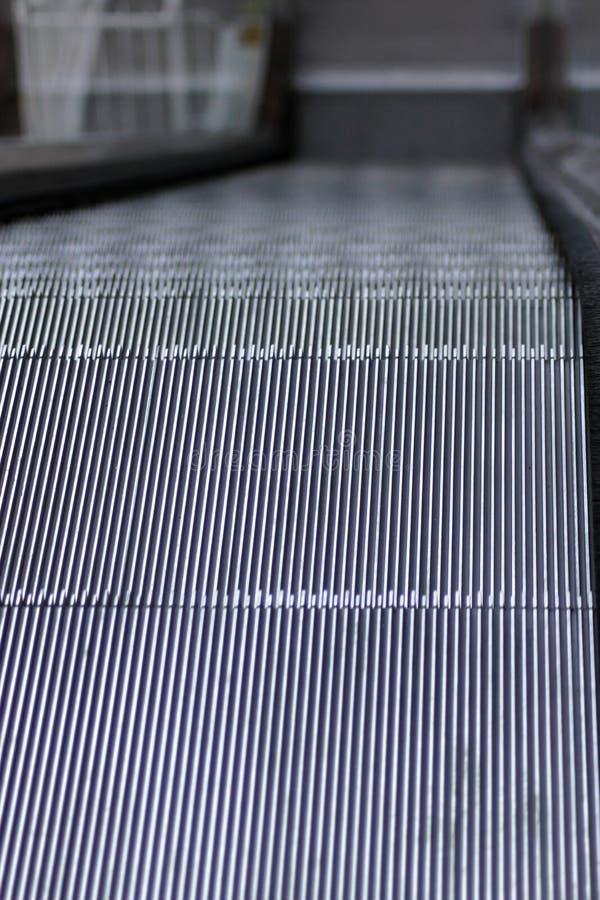 As etapas de uma escada rolante foto de stock