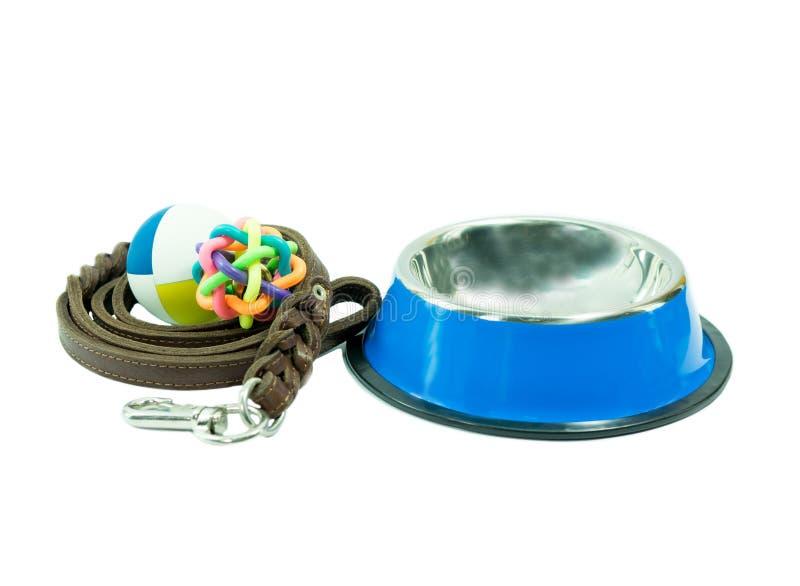 As fontes do animal de estimação ajustaram-se sobre a bacia inoxidável, brinquedos de borracha fotos de stock royalty free