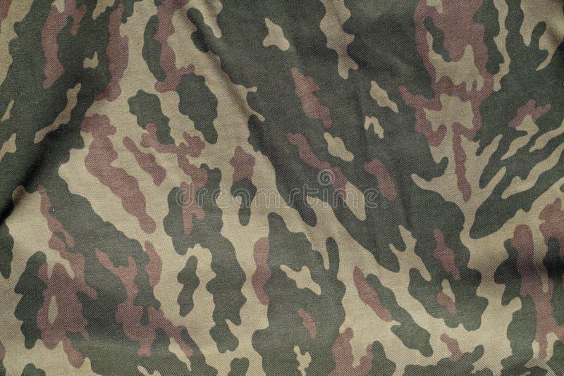 As forças armadas verdes e marrons camuflam o teste padrão uniforme fotografia de stock royalty free