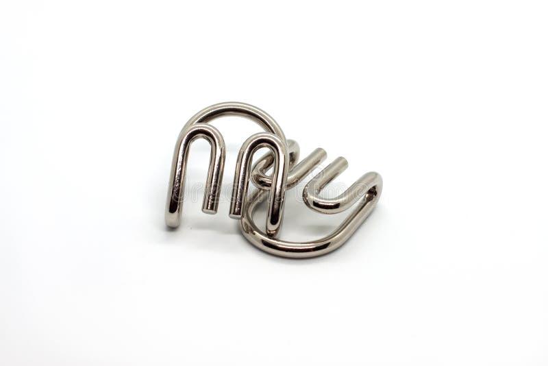 As garras do diabo moderno do enigma do molde do metal isoladas no fundo branco imagem de stock royalty free