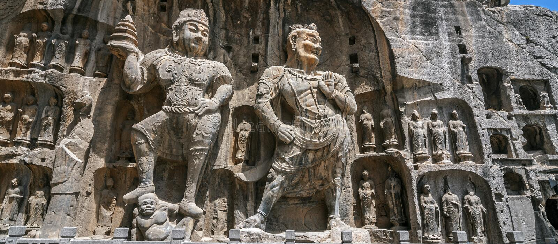 As imagens cinzeladas da Buda em Longmen cavam, Dragon Gate Grottoes imagens de stock royalty free