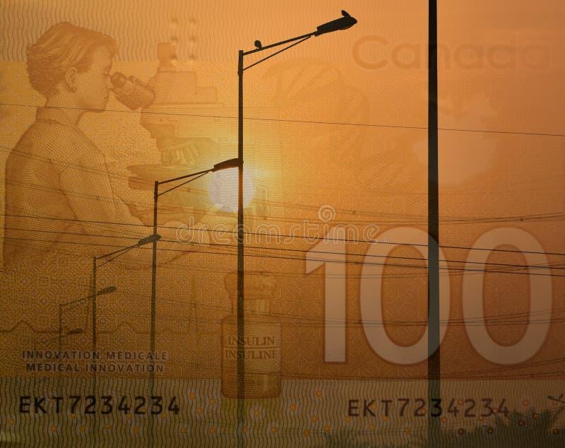 As lâmpadas de rua e a nota de dólar elétricas do canadense 100, um tiro da exposição dobro para demonstrar gastam na eletricidad imagem de stock