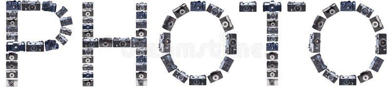As letras das câmeras retros velhas isolaram o fundo imagens de stock royalty free