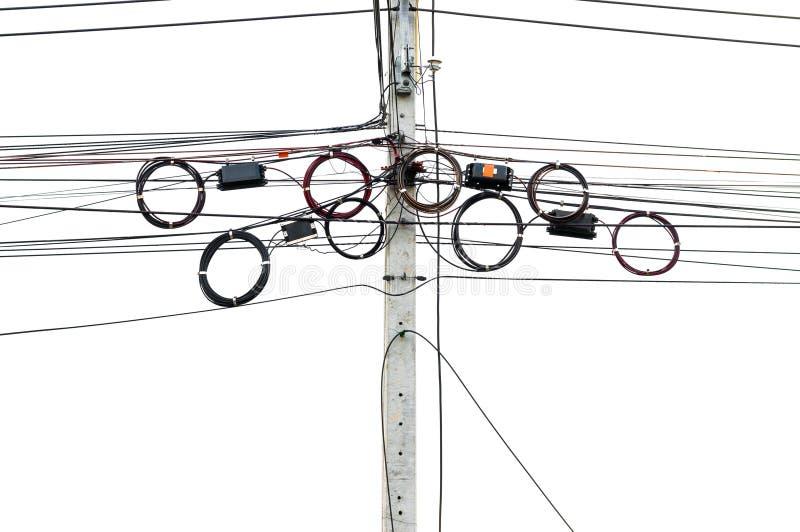As linhas de telecomunicação penduram no polo bonde fotografia de stock royalty free