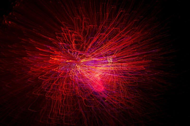 As luzes brilhantes coloridos da fibra ótica são borradas no movimento Fundo abstrato moderno para o feriado foto de stock