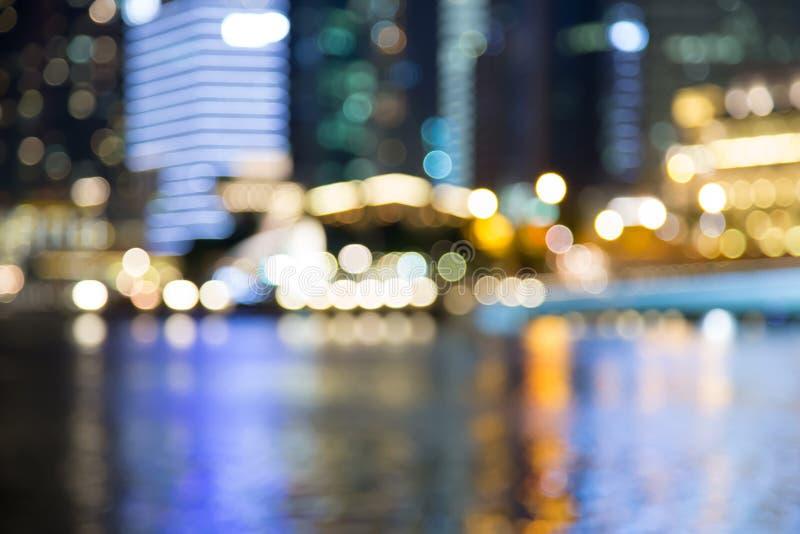 As luzes da noite da cidade de Singapura borraram o bokeh imagem de stock