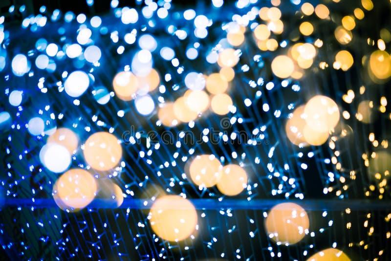 As luzes de Bokeh do verde amarelo e do rosa do fundo abstrato seririam para cada festival imagem de stock