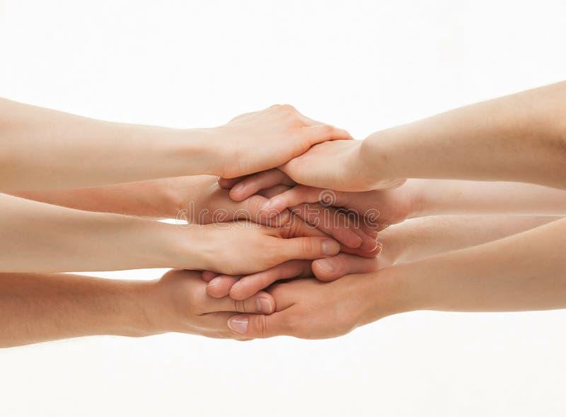 As mãos agrupam no fundo branco fotografia de stock royalty free