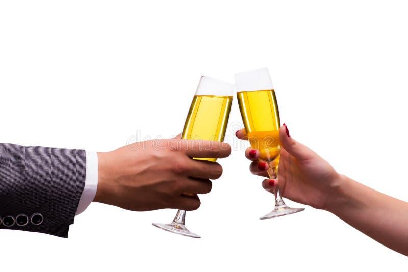 As mãos com os vidros do champanhe isolados no branco imagem de stock royalty free