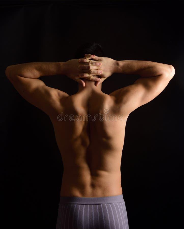 As mãos cruzaram-se na nuca do pescoço, foto na parte traseira fotografia de stock royalty free