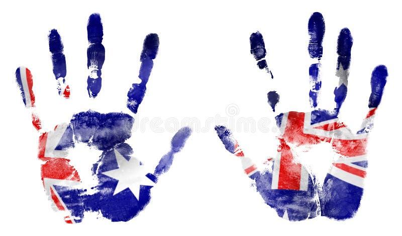 As mãos da impressão nas cores da bandeira australiana imagem de stock