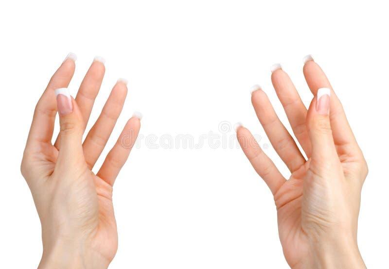 As mãos da mulher bonita isoladas no branco fotos de stock