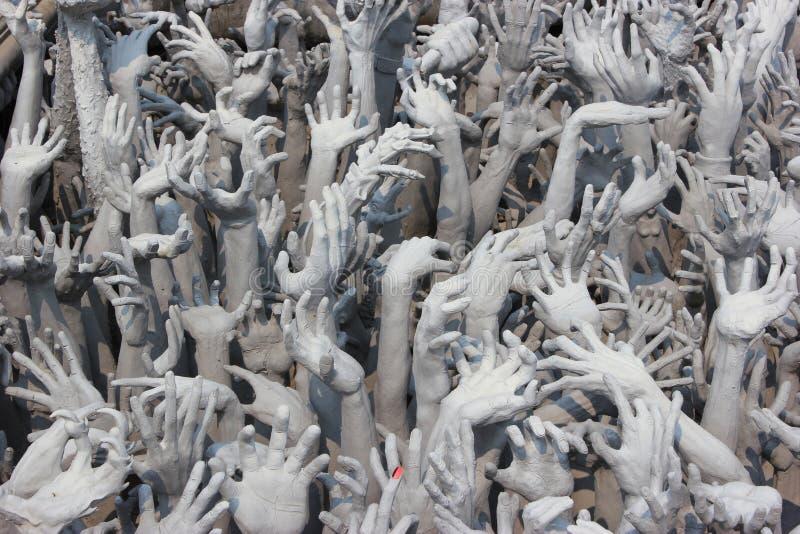 As mãos do diabo do inferno, uma de muitas decorações bonitas no Ro fotos de stock