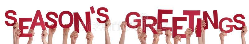 As mãos dos povos que guardam a palavra vermelha temperam cumprimentos foto de stock