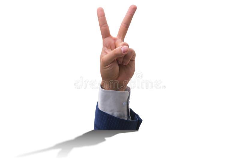 As mãos que mostram a vitória assinam dentro o conceito do negócio fotografia de stock