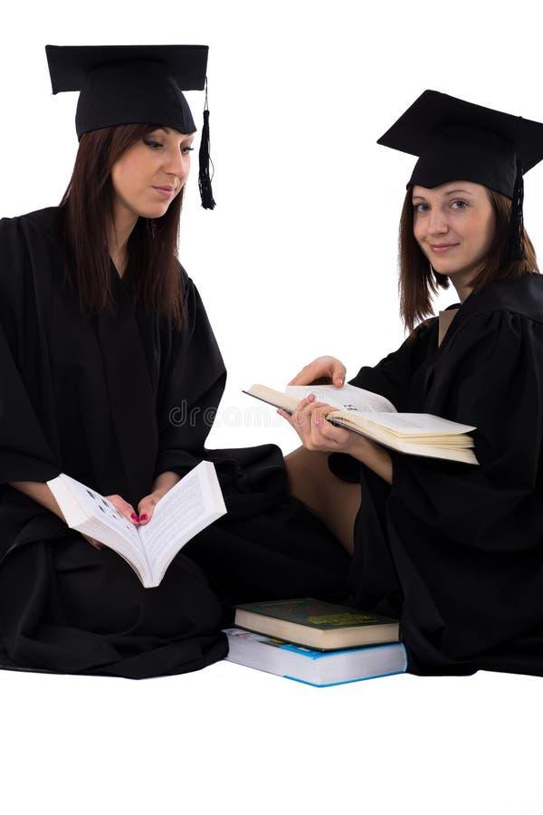 As moças no estudante envolvem com a pilha de livros fotografia de stock royalty free