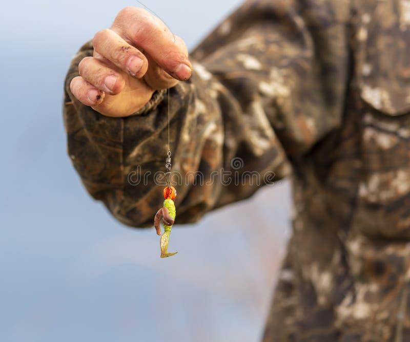 As mostras do pescador atraem no gancho fotos de stock royalty free