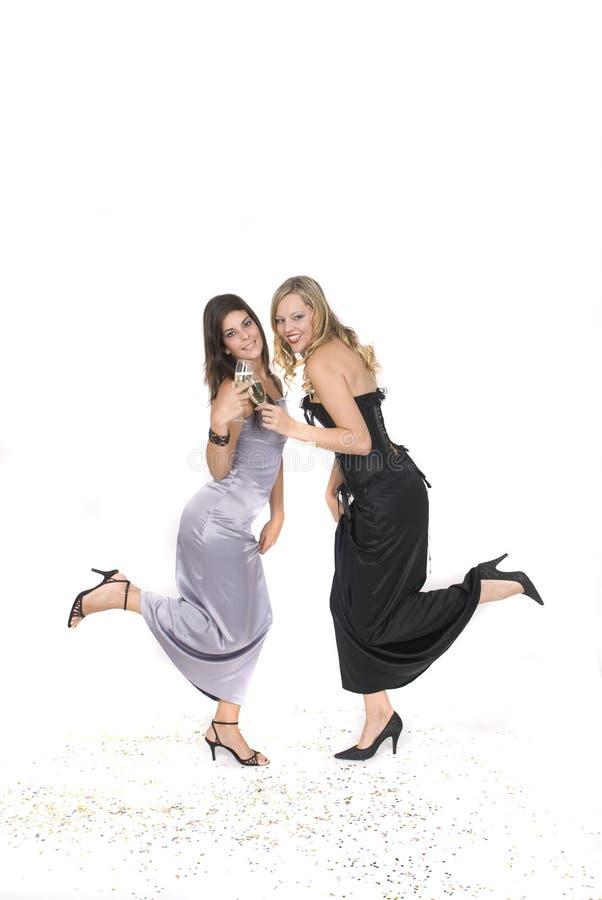 As mulheres com vidro com champanhe no ano novo party imagem de stock