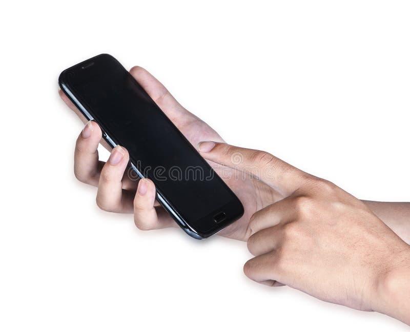 As mulheres da mão tocam no telefone esperto à disposição no fundo branco fotografia de stock