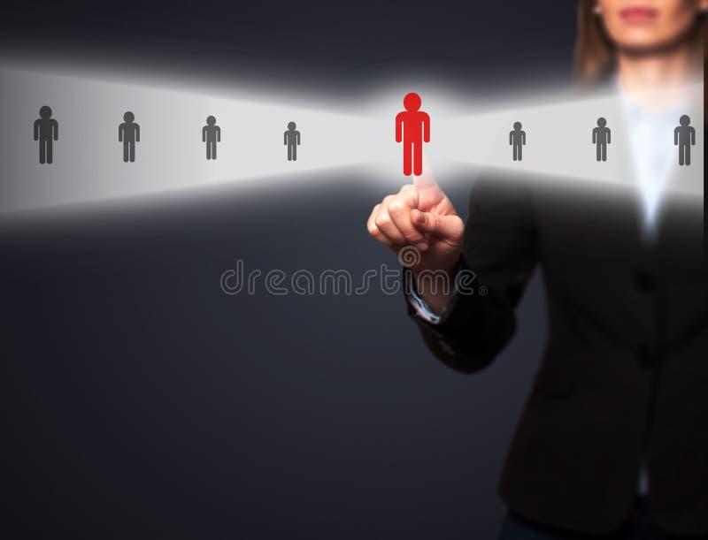 As mulheres de negócios entregam o empregado novo seleto da relação eletrônica foto de stock royalty free