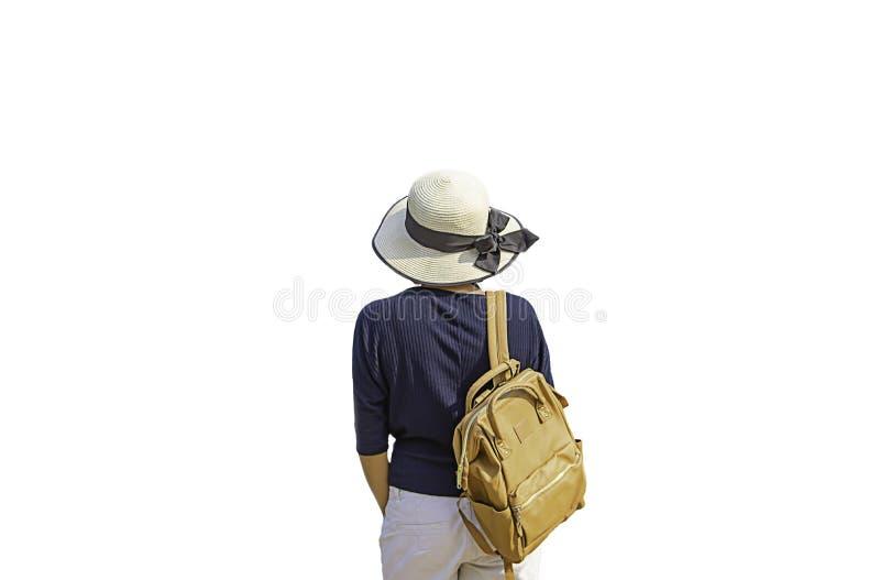 As mulheres empurram a trouxa e vestem um chapéu em um fundo branco fotos de stock