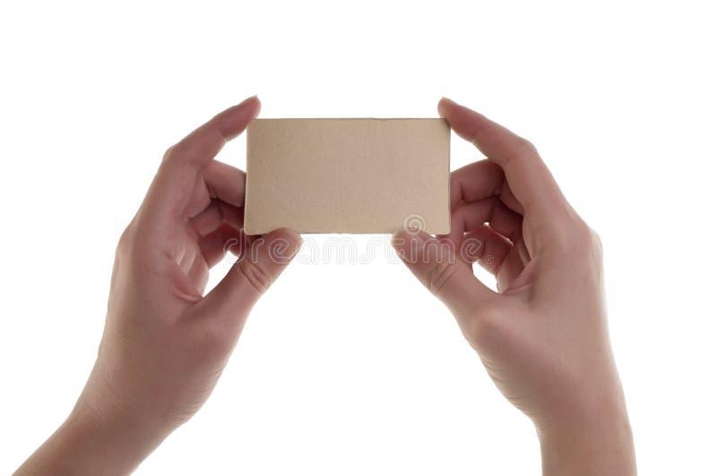 As mulheres entregam guardar o cartão vazio imagens de stock