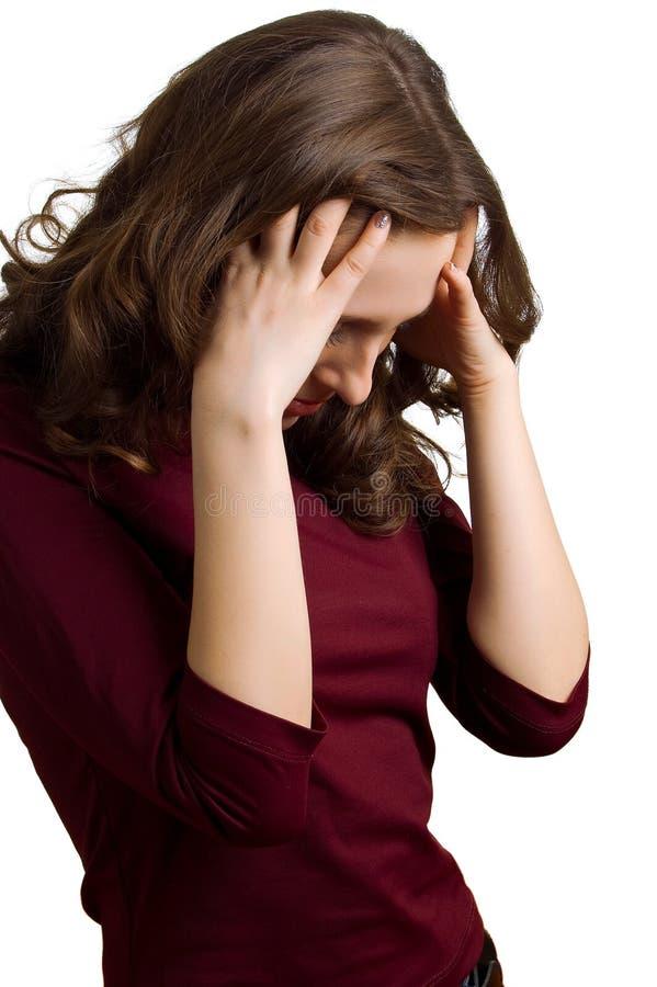 As mulheres novas têm uma dor de cabeça fotos de stock royalty free