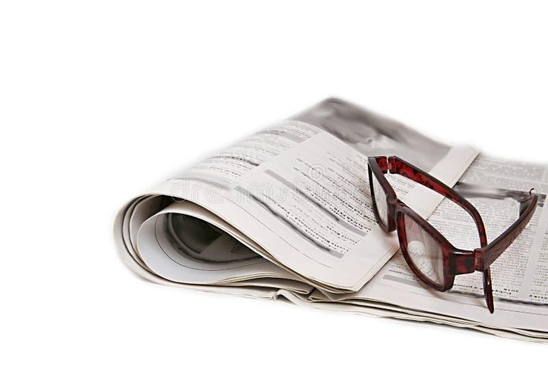 As notícias forram com vidros fotografia de stock royalty free