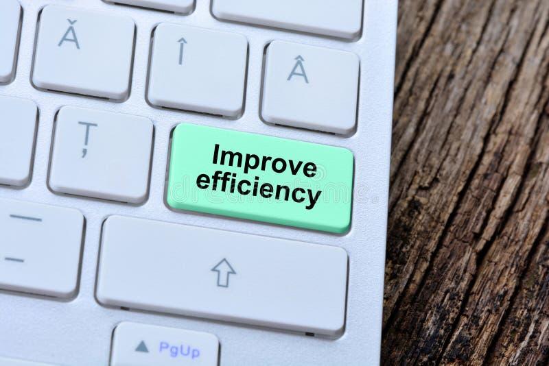 As palavras melhoram a eficiência no botão do teclado de computador fotografia de stock
