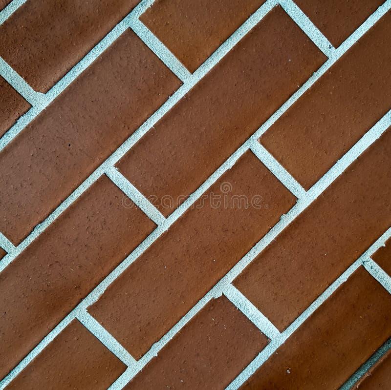 As paredes da construção são feitas do normal do tijolo conceito fresco da cor imagem de stock