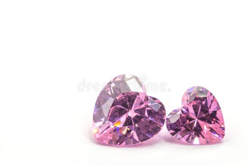 As safiras cor-de-rosa no coração dão forma no fundo branco imagens de stock royalty free