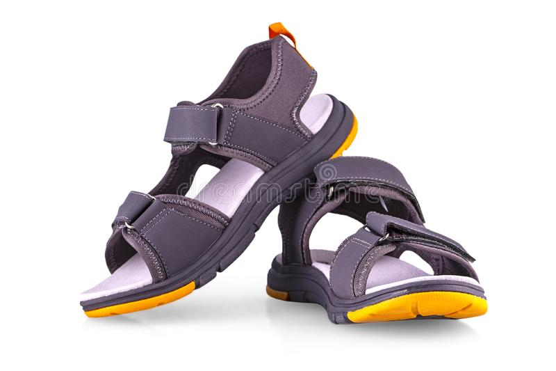 As sandálias dos esportes das crianças isoladas no branco imagens de stock