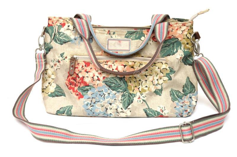 As senhoras coloridas lançam o saco com impressões florais fotografia de stock
