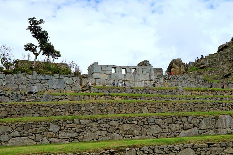 As sobras do templo da janela três em Machu Picchu Inca Citadel, local arqueológico em Cusco, Peru fotos de stock