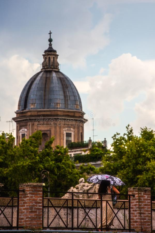 Rome Rain Afternoon Lazio, Italy. As summer transitions to autumn, Rome often sees a newfound appreciation for rain. Umbrellas are widely available for passing stock photo