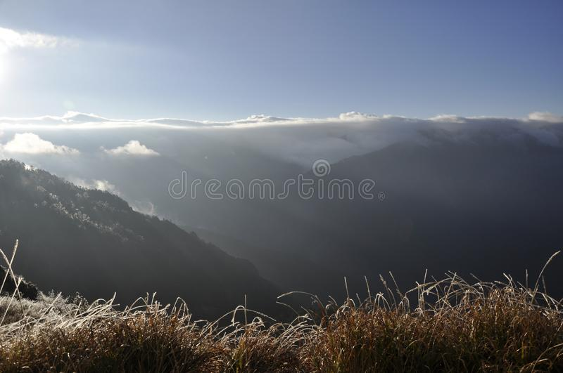 Sunrise on mountain. As the sunrise just rises, we ascend to a higher peak to see a more beautiful view royalty free stock images