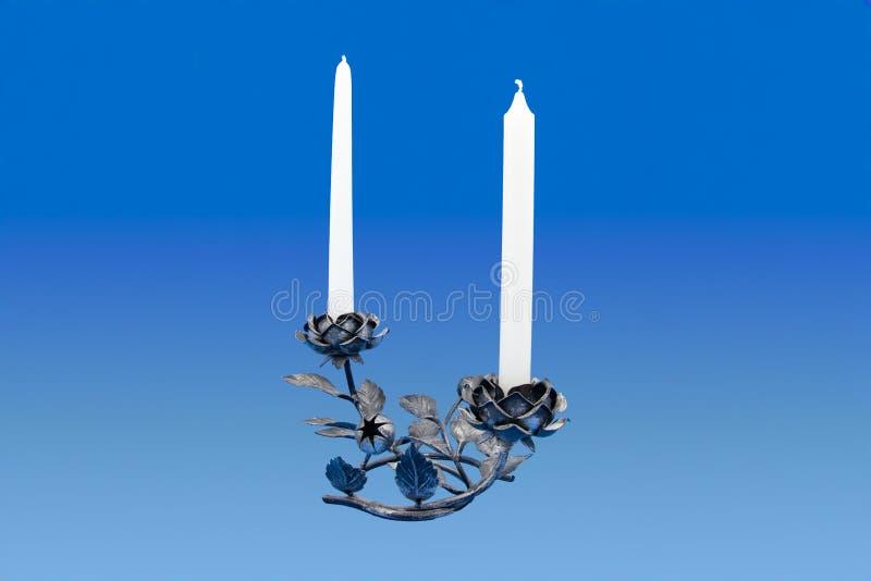 As velas e o ferro aumentaram suporte imagens de stock