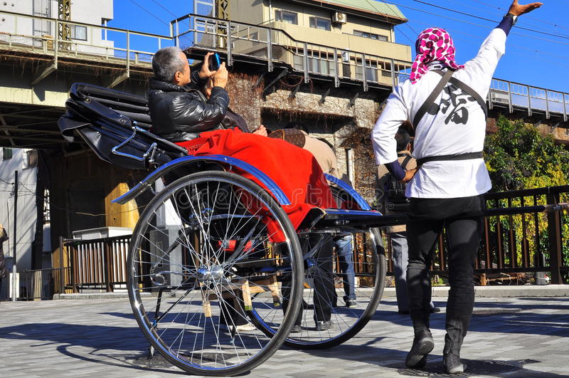 Download Asakusa Rickshaw With A Tourist And The Puller Editorial Stock Photo - Image of driver, crowd: 17643918