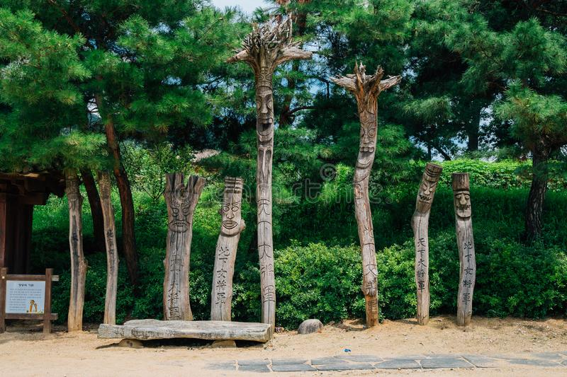 Jangseung, Korean traditional totem pole with green tree stock image