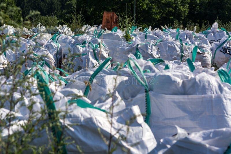 Asbestos with asbestos warning sign. stock images