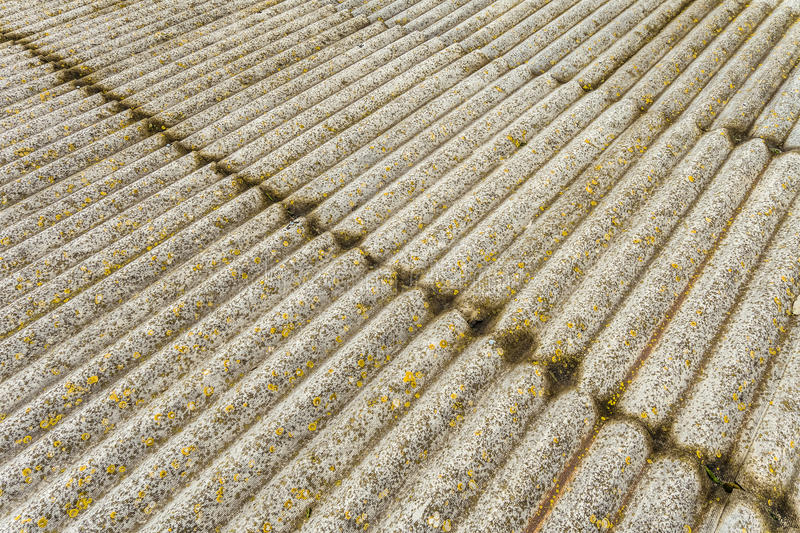 Asbestos cement sheets. Texture of old laid roofing sheets. Grey old roof stock photos
