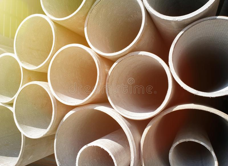 asbestos pipes stacked in a row on each other close up royalty free stock photo