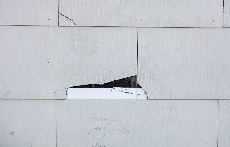 Asbestos siding cracking on home stock photos