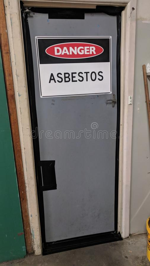 Asbestos warning sign on door royalty free stock photography