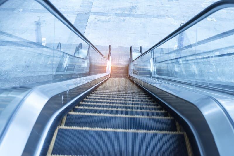 Ascending escalator in transport area stock image