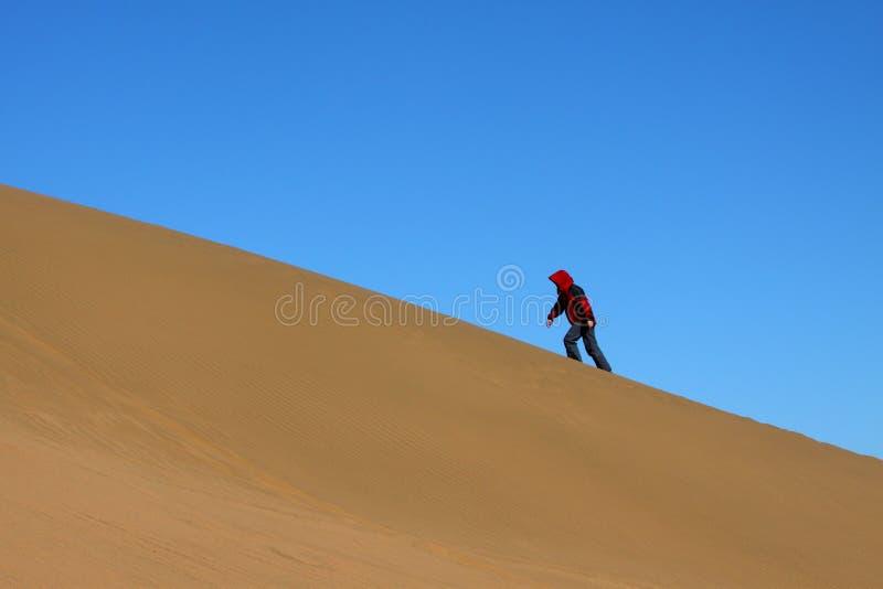 Ascending the sand dune stock photos