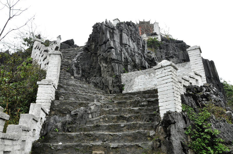 Ascending stone staircase to Hang Mua pagoda, Ninh Binh, Vietnam. Ascending stone staircase to the Hang Mua pagoda, Ninh Binh, Vietnam royalty free stock photography