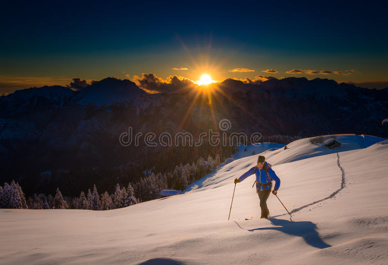 Ascending to the top. Ski mountaineering Cross country skiing al stock photography